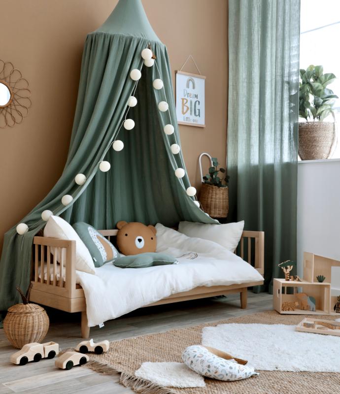 Kidsroom with muslin textiles in khaki & cream