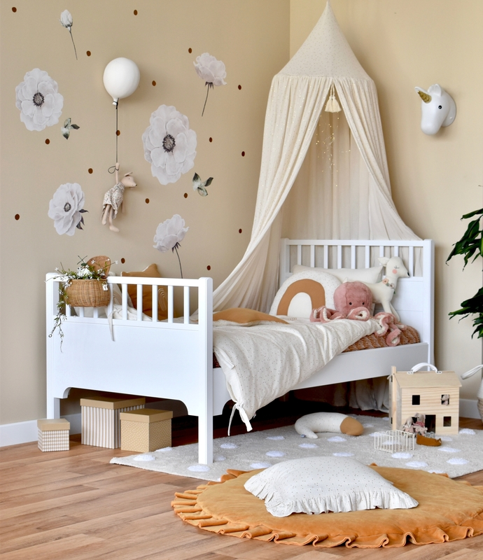 Toddler room with textiles in cream & gold